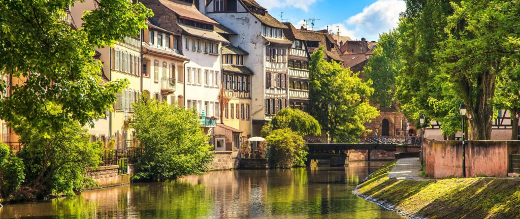 22672042 - strasbourg, water canal in petite france area  half timbered houses and trees in grand ile  alsace, france